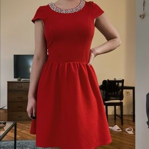 red dress with beaded neckline